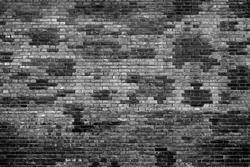 Black brick wall background, brickwall texture aging effect. Grunge rusty brick wall as brickwork background texture. Rustic revival masonry black brick wall or brickwall texture, obsolete background