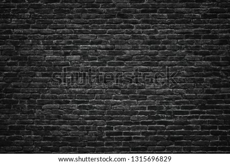 Black brick wall background.  stonework texture gloomy