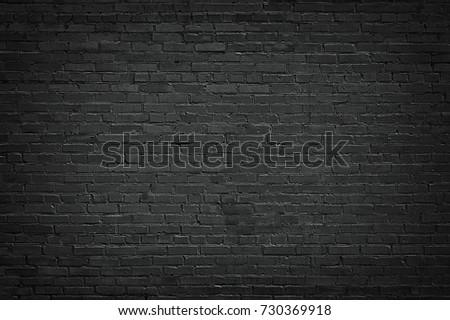 black brick wall background. texture dark masonry #730369918