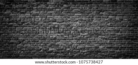 Black brick wall background, texture of old dark stone wall