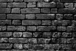 Black brick wall of a dead end. It embodies the inability to move on.