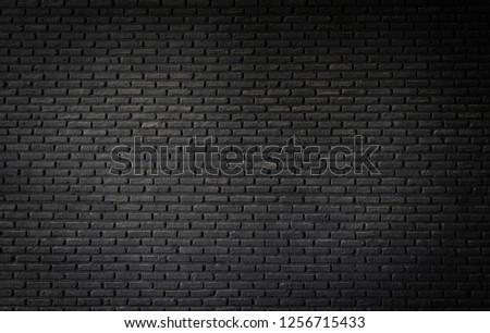 Black brick wall texture, brick surface background. Vintage floor wallpaper.