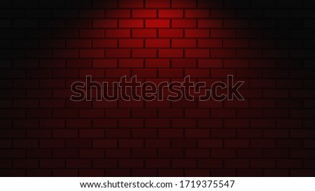 Black brick wall with red neon light with copy space. Lighting effect red color glow on brick wall background. Royalty high-quality free stock photo image of blank, empty background for texture