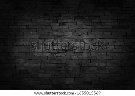 Black brick walls that are not plastered background and texture. The texture of the brick is black. Background of empty brick basement wall.