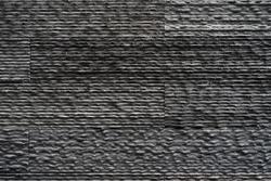 Black bricks slate texture background, slate stone wall texture.