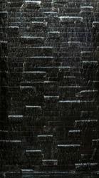 Black bricks under running water rough photo texture background