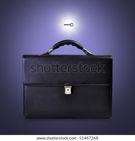 Black briefcase and key to it
