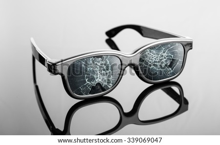 Black broken sunglasses on the table