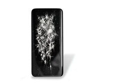Black broken touch screen phone isolated on a white background with shadow