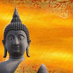 Black Buddha statue on gold pattern Thailand.