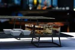 Black buffet table with beautiful decorated dishes. Breakfast at hotel. Catering. Decoration for a Banquet. High quality photo