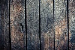 Black burnt wooden fence