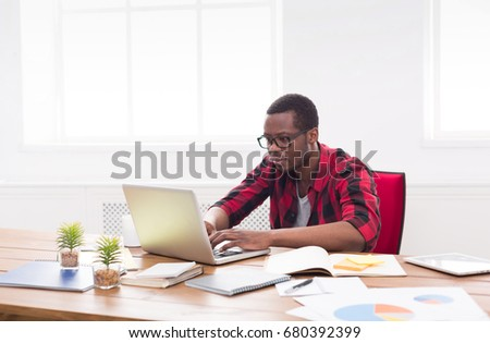 Black businessman in office, in casual, work with laptop