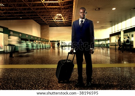 Black businessman with suitcase at the airport