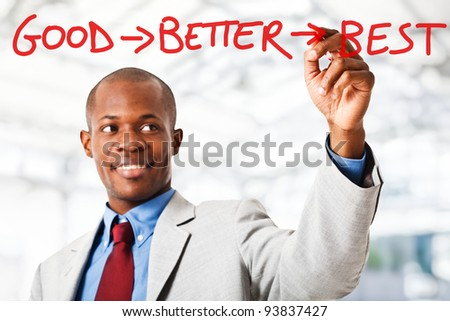Black businessman writing a motivational concept on the screen