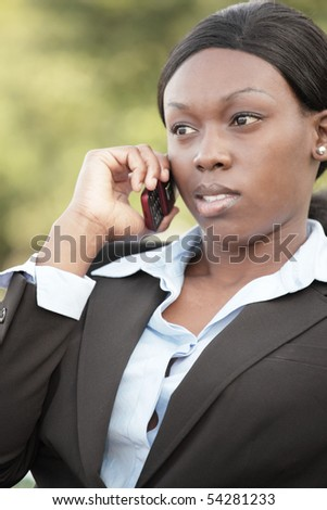Black businesswoman on the phone - stock photo
