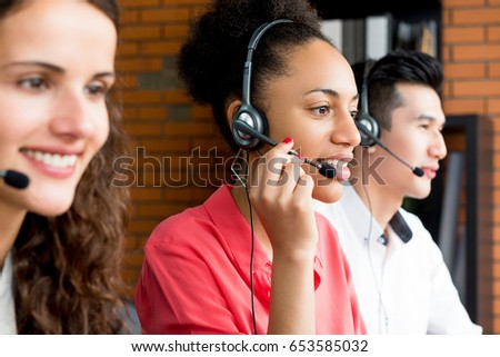 Black businesswoman working in call center with her multiethnic team #653585032