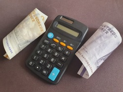 black calculator and Danish banknotes of different denominations
