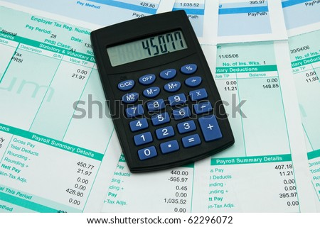 black calculator and payroll summary details