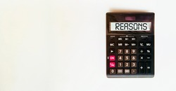black calculator with text Reasons on the white background