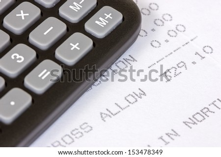 Black calculator with the printed receipt of  allowance