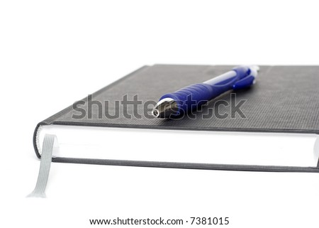 black calendar with blue pen isolated on white