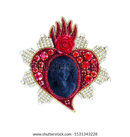 Black cameo with a red heart with rhinestones. Isolated on white background #1531343228