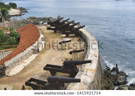 Black cannons of the fortress in front of the sea #1415921714