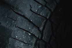 black carbon charcoal dry crack old tire dark color for background.