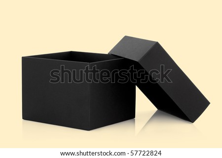 Black cardboard box with the lid off over pastel yellow background with reflection.