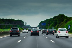 Black cars and white cars on the german autobahn