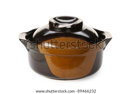 Black casserole dish or crock pot, isolated on white.