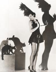 Black cat giving woman in costume the heebie-jeebies