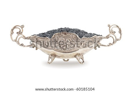 Black caviar in a silver bowl isolated