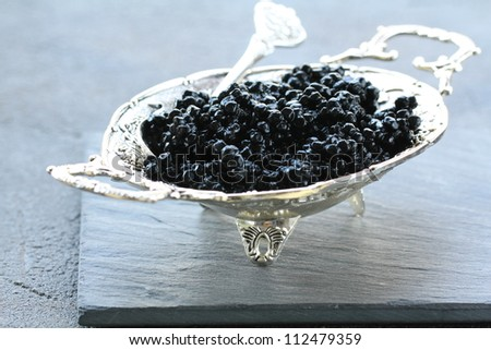 black caviar -  luxurious delicacy appetizer - stock photo