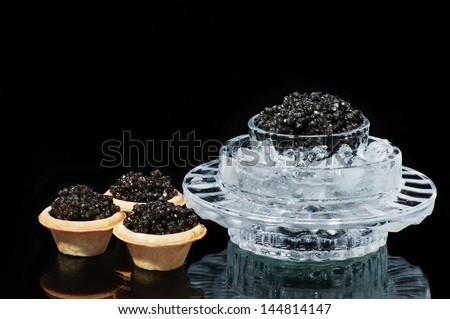 Black caviar on a black background isolated studio photo