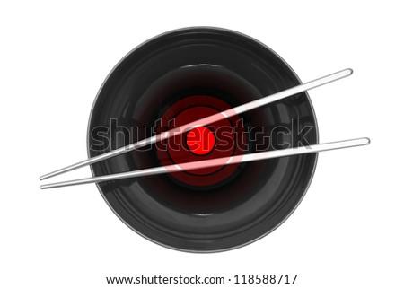 Black ceramic bowl with silver chopsticks