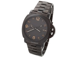 Black ceramic watch on a white background, nobody. An elegant men's watch of black color with orange figures.