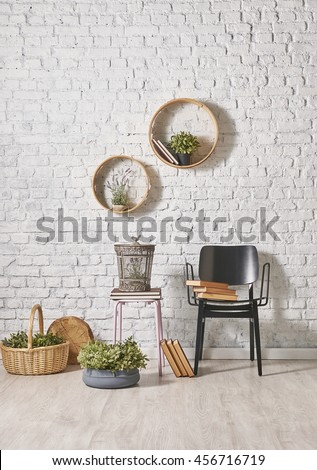 black chair and brick wall decor with round frame
