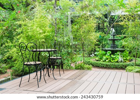 Black chair in the garden for relax