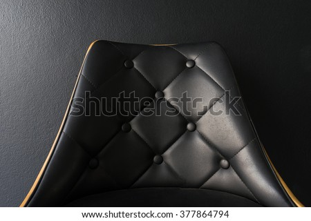 Black chair with black background closeup