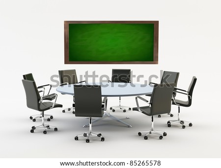 Black chairs around a light office table with a chalkboard