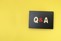Black chalkboard with block letters on Q & A, questions and answers concept
