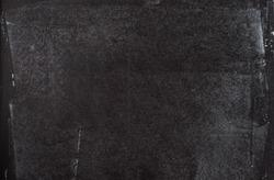 Black chalkboard with chalk dust