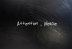Black chalkboard with  text handwritten ATTENTION PLEASE, concept of request or command one or public, to listen carefully or give more interest