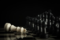 Black chess army defeats white king on the chess board.