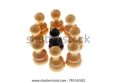 black chess figure surrounded with white ones, isolated on white background