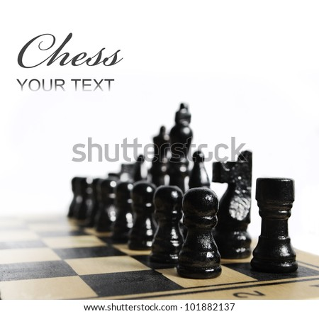 Black chess pieces on chess board isolated over white