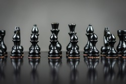 Black chess pieces. Selective focus.Reflection. Focus on the pawn. Strategy. Sport Business Background