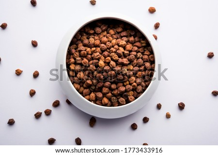 Photo of  Black Chick Pea or Kala Chana in a bowl, selective focus
